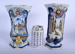 A PAIR OF 19TH CENTURY DUTCH DELFT FAIENCE TIN GLAZED VASES painted with landscapes. 22 cm x 12 cm.