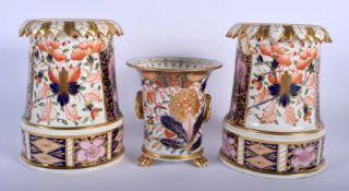 A PAIR OF EARLY 19TH CENTURY DERBY IMARI PORCELAIN VASES together with a Derby twin handled vase. La