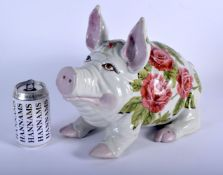 A LARGE VINTAGE SCOTTISH WEYMSS STYLE PIG painted with floral sprays. 36 cm x 25 cm.