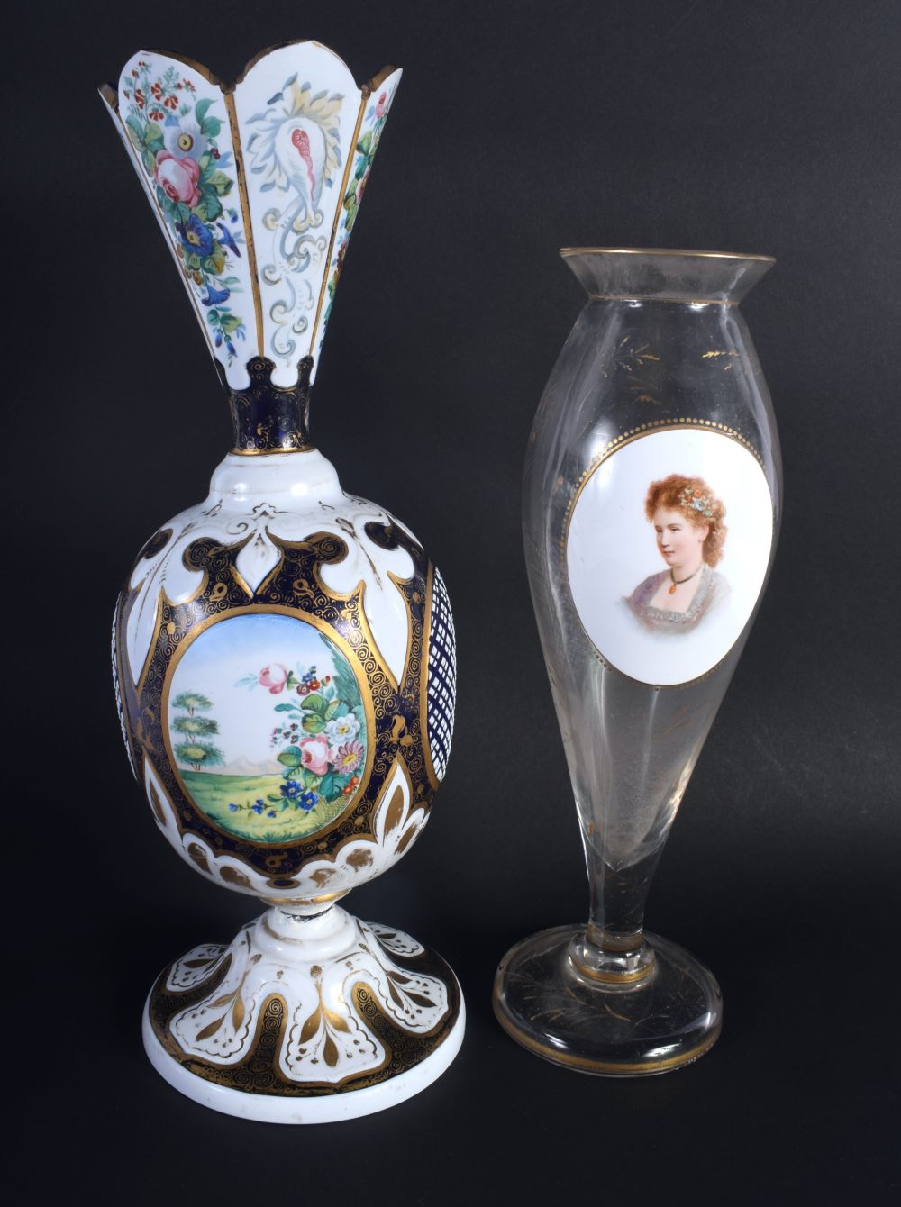 AN ANTIQUE BOHEMIAN ENAMELLED GLASS VASE together with a bohemian portrait vase. 32 cm high. (2)