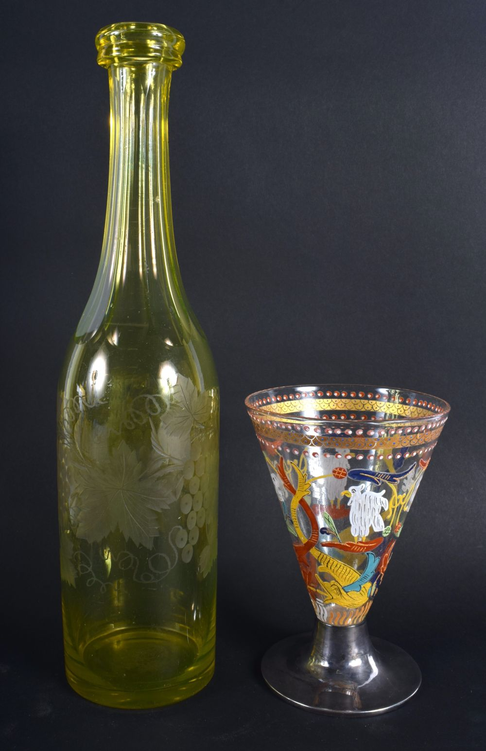 A VINTAGE YELLOW GLASS ENGRAVED DECANTER together with an early silver mounted European glass goblet - Image 2 of 2