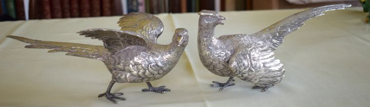 A LOVELY PAIR OF STERLING SILVER TABLE PHEASANTS by F & Son Ltd, well modelled in natural stances. 6