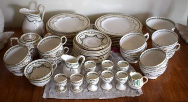 A THOMAS GOODE & CO PORCELAIN TEASET decorated with swags and vines. (qty)