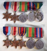 TWO WWII MEDAL GROUPS including territorial, with original ribbons. (10)