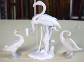 AN AUSTRIAN VIENNA PORCELAIN GROUP OF FLAMINGOS together with two Lladro porcelain ducks. Largest 23