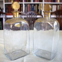 A PAIR OF ANTIQUE BOHEMIAN CLEAR AND GILDED STRAIGHT SIDED GLASS DECANTERS modelled in the neo class