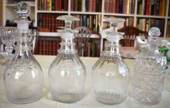A PAIR OF ANTIQUE CUT GLASS DECANTERS AND STOPPERS together with two other decanters. Largest 23 cm