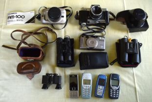 A COLLECTION OF VINTAGE 35MM CAMERAS together with four vintage Nokia phones, binoculars etc. (qty)
