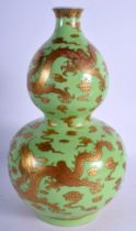 A VERY RARE CHINESE DOUBLE GOURD DRAGON VASE with golden cloud and dragion design on green ground.