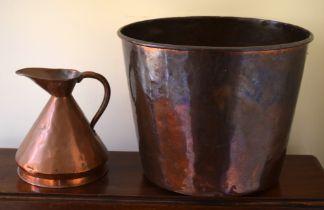 A VINTAGE COPPER WASTE PAPER BASKET, along with a small copper jug. Largest 30 cm x 27 cm. (2)