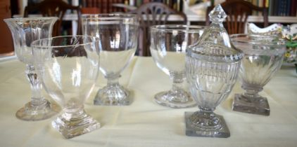 A REGENCY GUT GLASS VASE AND COVER possibly Irish, together with other antique glass pedestal bowls.