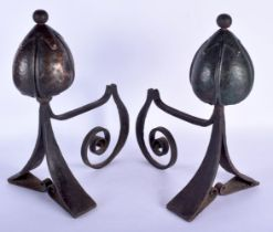 A STYLISH PAIR OF ART NOUVEAU COPPER AND WROUGHT IRON ANDIRONS of highly organic form. 40 cm x 30 cm