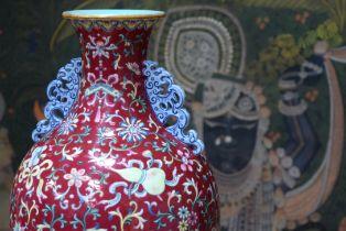A FINE CHINESE TWIN HANDLED FAMILLE ROSE PORCELAIN FALANCAI RUBY GLAZED VASE Qianlong mark and proba