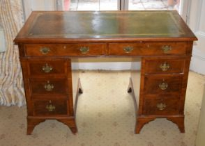 AN EARLY 20TH CENTURY SWEDISH MAHOGANY KNEEHOLE DESK together with another kneehole desk. Largest 12