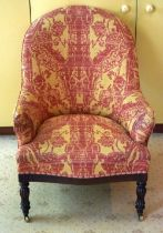 A VICTORIAN UPHOLSTERED ARM CHAIR with rectangular frieze and card legs. 90 cm x 60 cm.