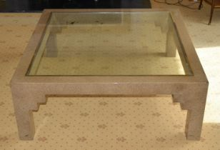 A MODERNIST DESIGNER IMITATION MARBLE COFFEE TABLE with glass top and brass surround. 110 cm square.