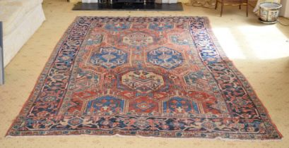 AN ANTIQUE MIDDLE EASTERN CARPET decorated with motifs on a red and blue ground. 300 cm x 195 cm.