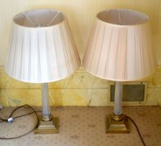A PAIR OF 19TH CENTURY FRENCH CRYSTAL GLASS AND BRASS CANDLESTICKS converted to lamps. Candle 48 cm
