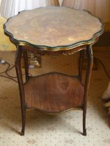 A LATE 19TH CENTURY CONTINENTAL BRONZE OVERLAID SIDE TABLE with shaped glass top and scrolling legs.