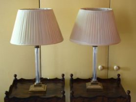 A PAIR OF 19TH CENTURY BRASS AND CRYSTAL CANDLESTICK LAMPS of acanthus capped form. 39 cm high.