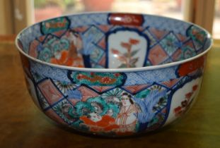 A 19TH CENTURY JAPANESE IMARI PERIOD PORCELAIN BOWL painted with flowers and vines. 22 cm x 11 cm.