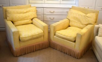 A PAIR OF DEEP COUNTRY HOUSE STYLE YELLOW ARM CHAIRS with associated gypsy table. (3)