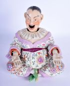 A 19TH CENTURY DRESDEN PORCELAIN NODDING FIGURE OF A CHINAMAN Meissen style, painted with flowers an