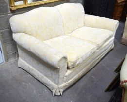 A GOOD QUALITY YELLOW GROUND UPHOLSTERED TWO SEATER SOFA. 182 cm x 100 cm.