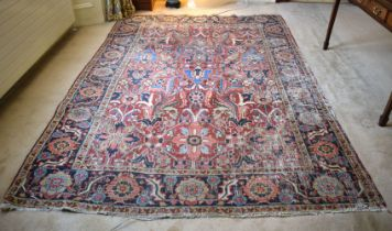 AN ANTIQUE MIDDLE EASTERN CARPET decorated with flowers. 290 cm x 200 cm.