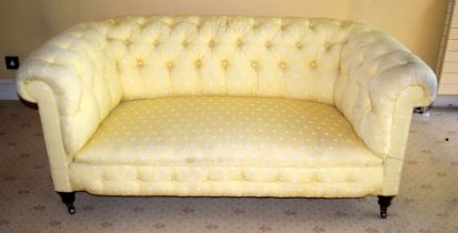 A GOOD QUALITY YELLOW GROUND UPHOLSTERED THEE SEATER SOFA. 150 cm x 65 cm.