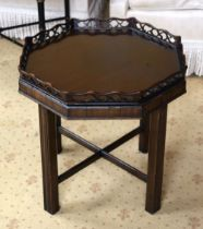 A GEORGE III STYLE CHIPPENDALE TYPE MAHOGANY TRAY ON STAND with inset glass top. 50 cm x 45 cm,
