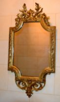 A GOOD LARGE 19TH CENTURY CONTINENTAL CARVED WOOD MIRROR of scrolling form. 105 cm x 55 cm