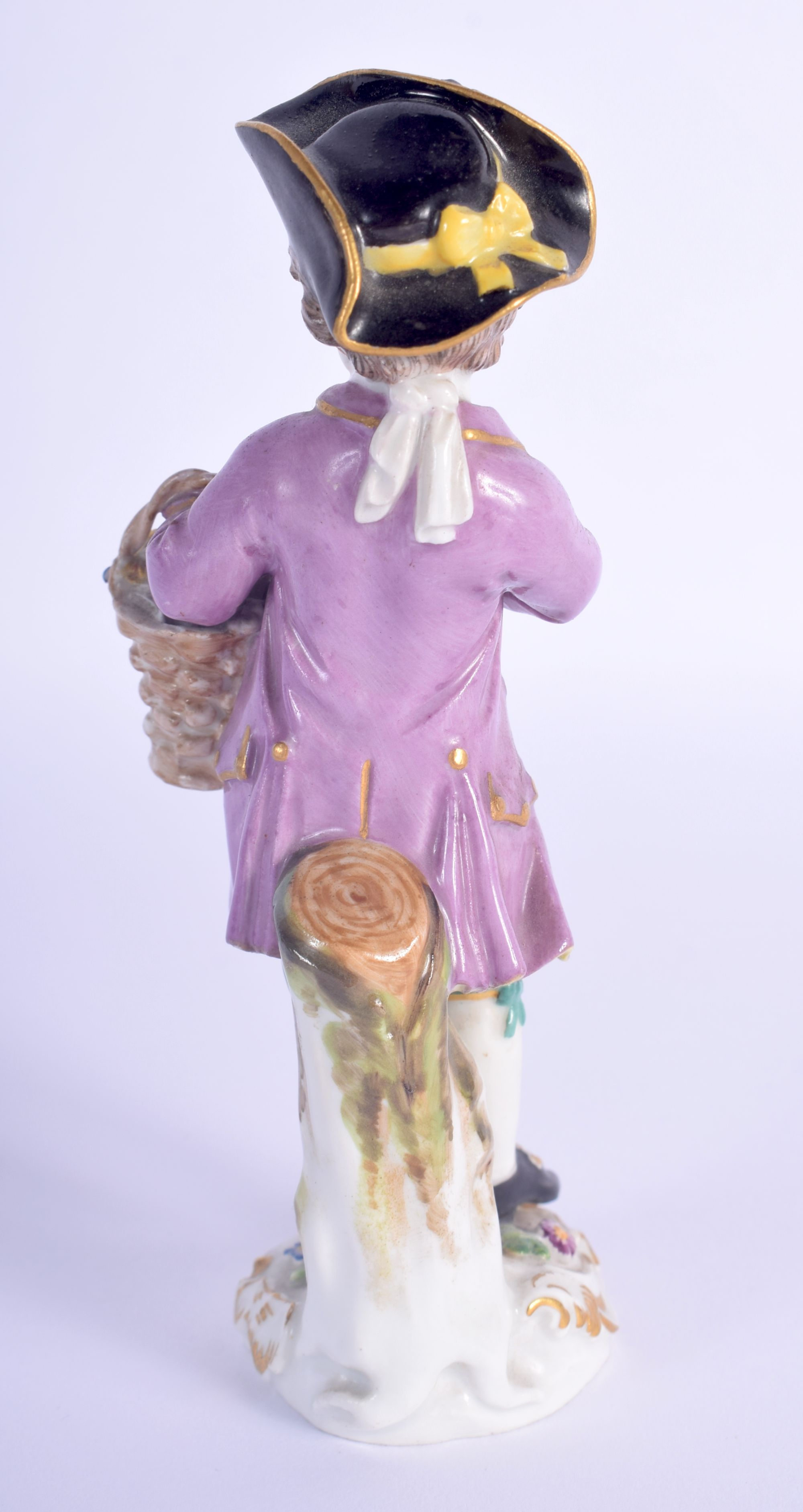 AN ANTIQUE MEISSEN PORCELAIN FIGURE OF A STANDING MALE modelled holding a basket of flowers. 13 cm h - Image 2 of 3