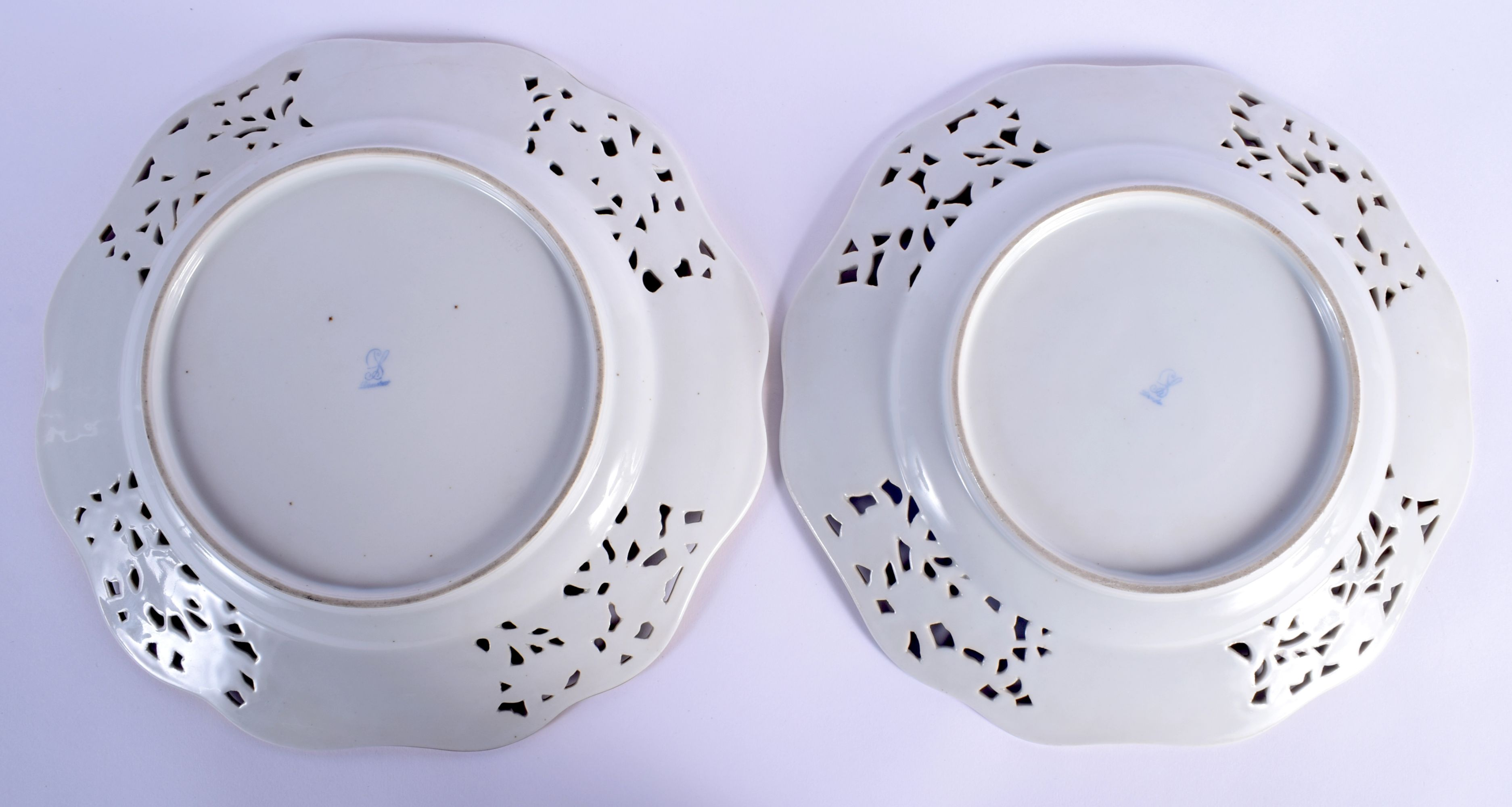 A PAIR OF EARLY 20TH CENTURY DRESDEN RETICULATED PORCELAIN PLATES painted with flowers. 26 cm wide. - Image 2 of 2