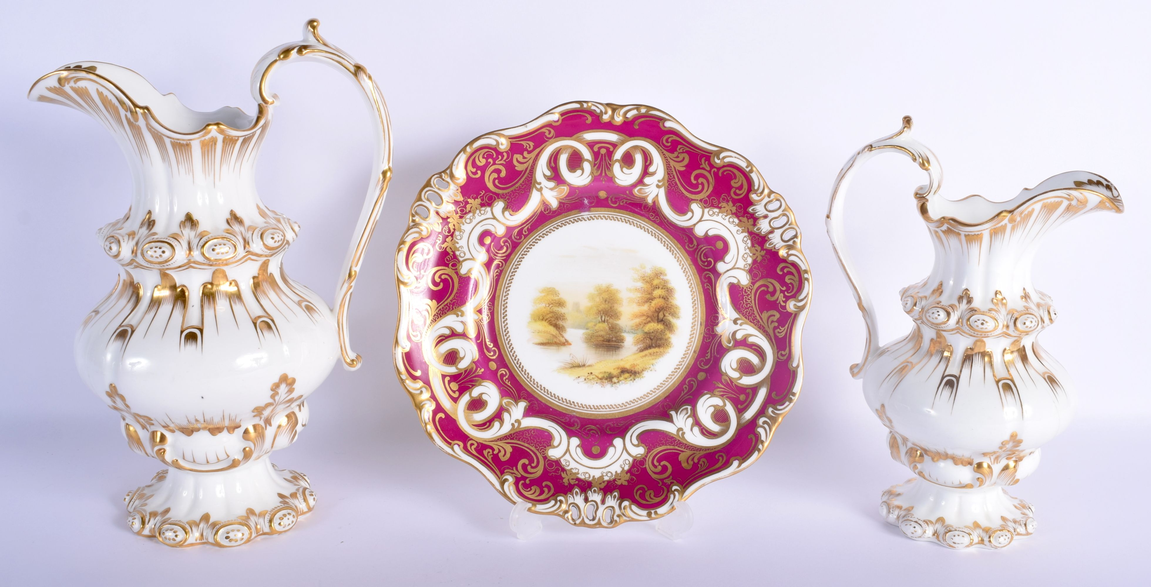 A LARGE NEAR PAIR OF EARLY 19TH CENTURY ENGLISH PORCELAIN JUGS of unusual form, together with a Dave