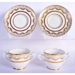 A PAIR OF EARLY 19TH CENTURY TWIN HANDLED GILDED CUPS AND SAUCERS Coalport or Derby, painted with ne