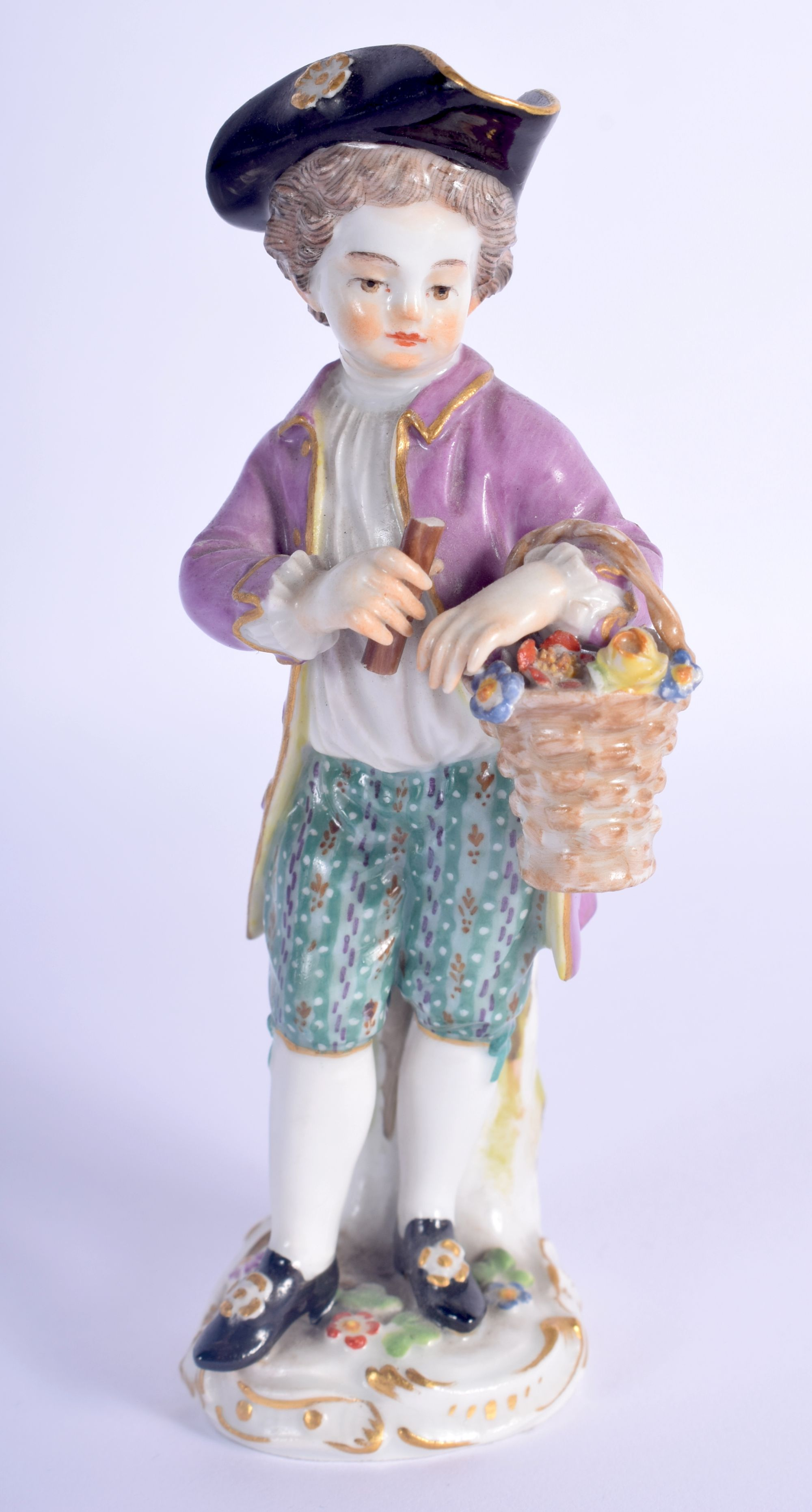 AN ANTIQUE MEISSEN PORCELAIN FIGURE OF A STANDING MALE modelled holding a basket of flowers. 13 cm h