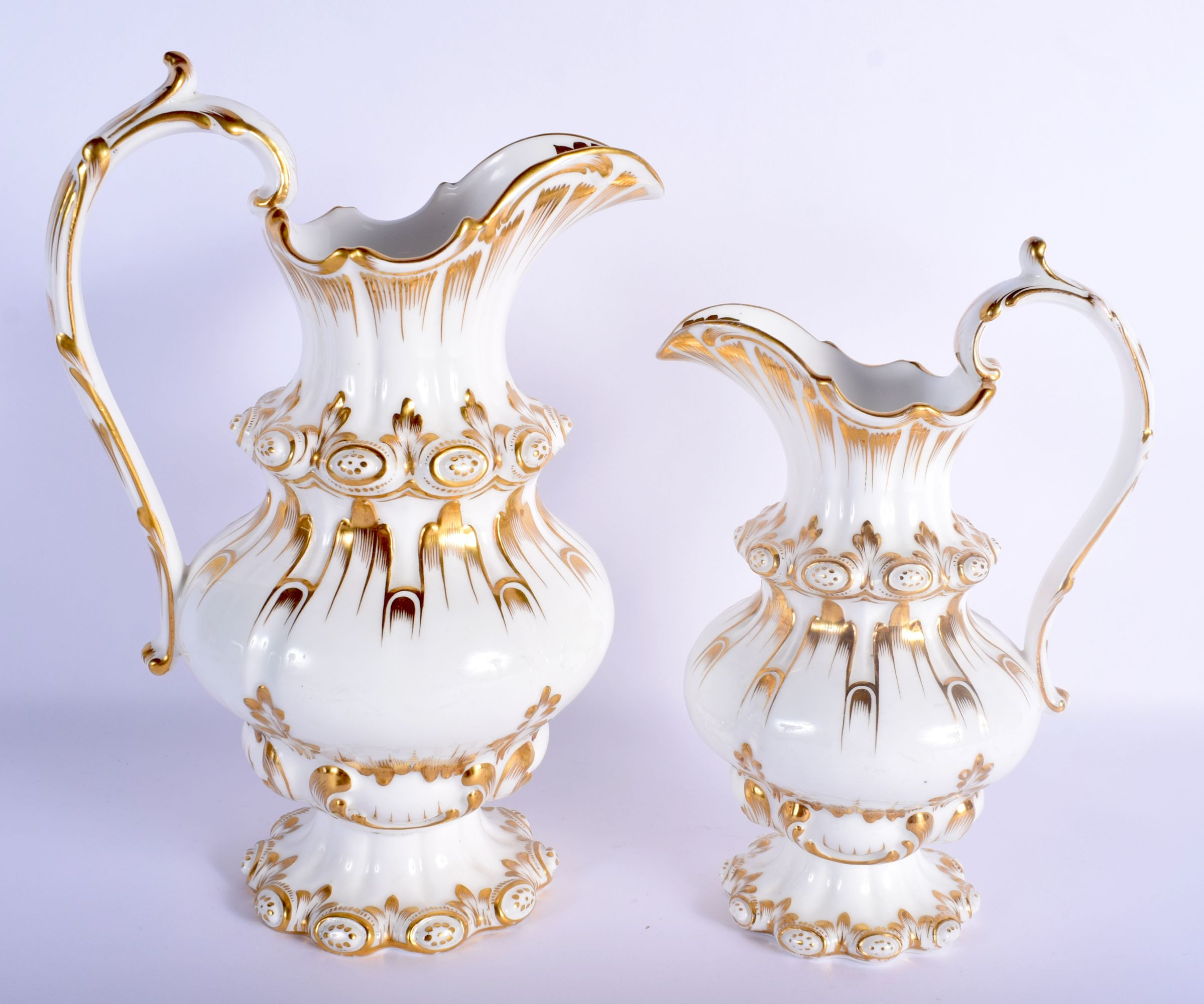 A LARGE NEAR PAIR OF EARLY 19TH CENTURY ENGLISH PORCELAIN JUGS of unusual form, together with a Dave - Image 2 of 4