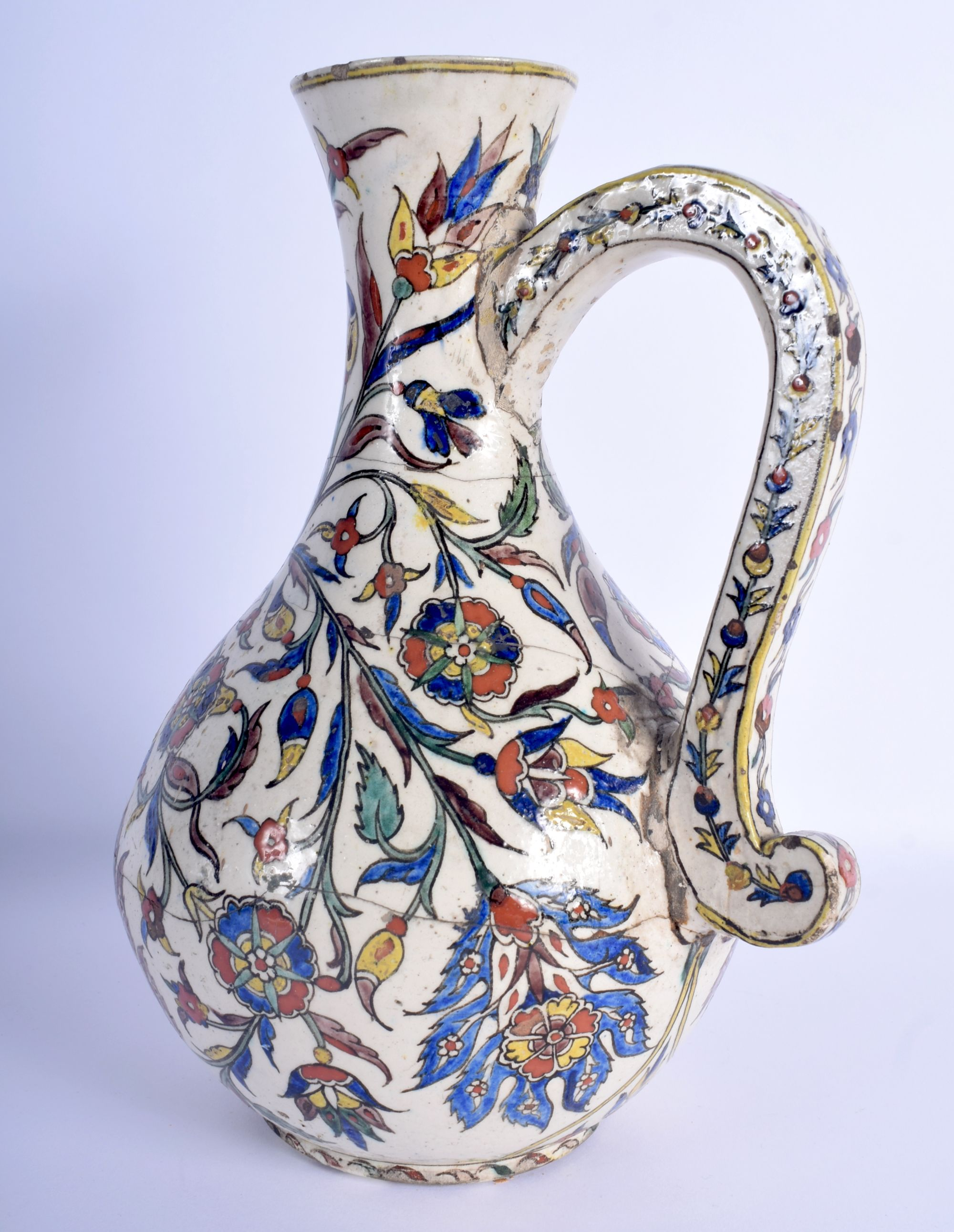 A 19TH CENTURY CONTINENTAL IZNIK FAIENCE GLAZED ENAMELLED JUG possibly Kutahya (Ottoman) painted wit - Image 3 of 4