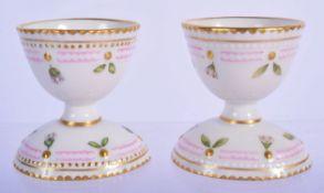 A PAIR OF ROYAL COPENHAGEN FLORA DANICA PORCELAIN EGG CUPS together with a Minton style Dresser bowl