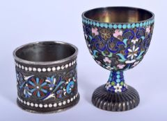 AN ANTIQUE RUSSIAN SILVER AND ENAME EGG CUP together with a similar Russian enamel napkin ring. 102