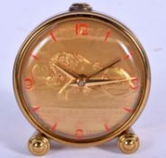 AN UNUSUAL VINTAGE BRASS WIND UP LION ALARM CLOCK with red numerals. 5.75 cm wide.