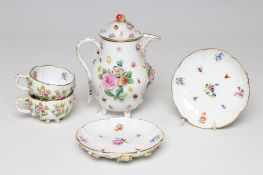 A PAIR OF MEISSEN PORCELAIN CABINET CUPS AND SAUCERS, late 19th century, of lobed form raised upon