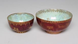 TWO GRADUATED WEDGWOOD BUTTERFLY LUSTRE BOWLS with gilt printed mottled puce ground and iridescent