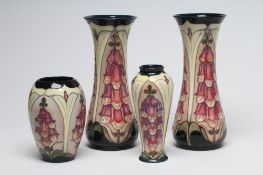 FOUR MOORCROFT FOXGLOVE VASES designed by Rachel Bishop, comprising a tall pair of waisted