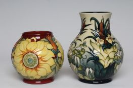 """A MOORCROFT INCA SUNFLOWER VASE, 1995, of spherical form, 6 1/2"""" high, together with a Lamia vase,"""
