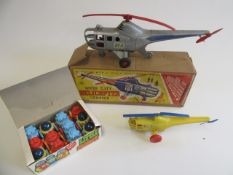 Tudor Rose friction helicopter, plastic helicopter and a box of twelve friction plastic robots, F-