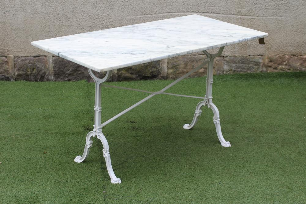 A GARDEN TABLE, modern, the oblong veined white marble top on painted metal end supports, the