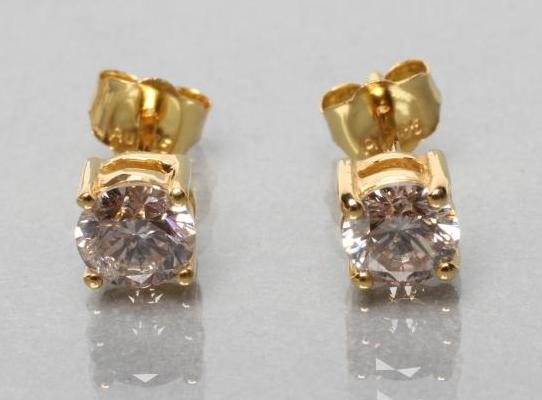 A PAIR OF DIAMOND SOLITAIRE EAR STUDS, each brilliant cut stone of approximately 0.5cts, claw set to