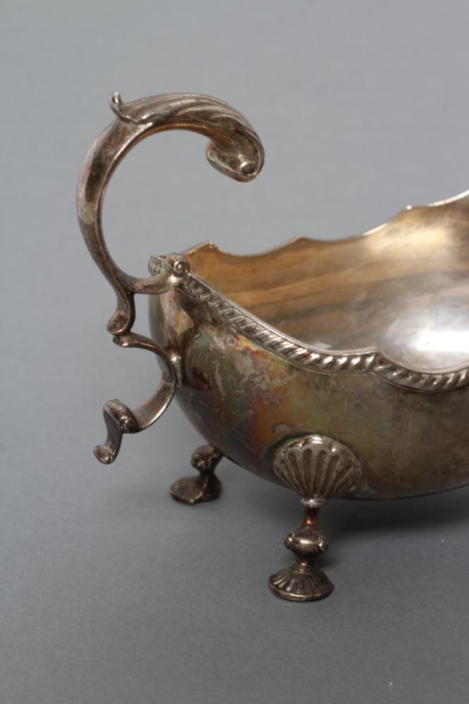 A GEORGIAN STYLE SILVER SAUCEBOAT, maker A Marston & Co., Birmingham 1978, the oval bowl with cast - Image 2 of 2